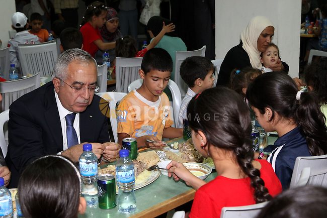 "Palestinian Prime Minister, Salam Fayyad during his participation Orphans of the Orphan Care Charitable Society the meal of ""Iftar"" in the month of Ramadan in the West Bank city of Bethlehem on Aug. 11, 2011. Photo by Mustafa Abu Dayeh"