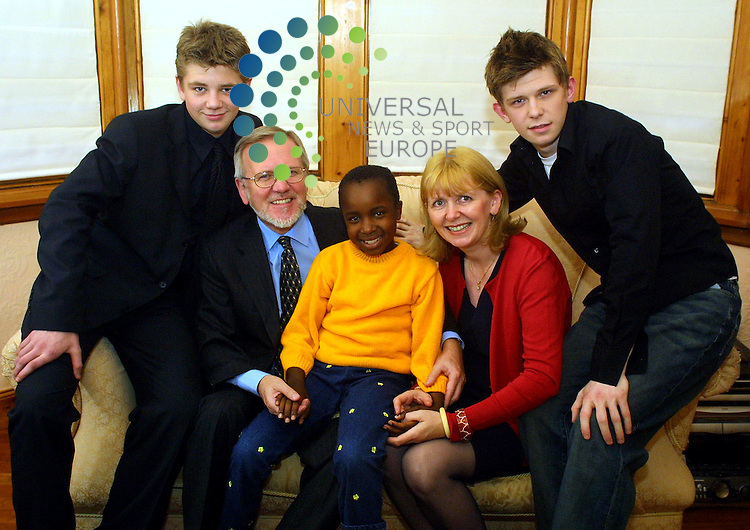 Maurice McDonald.  Bette and  Winnie Gibb..Bette rescued winnie (aged 7) from a Kenyan Home.she hopes to adopted her..From left to right, Andrew (15),  Father David, Winnie (7),.Bette Gibb, David (18)..