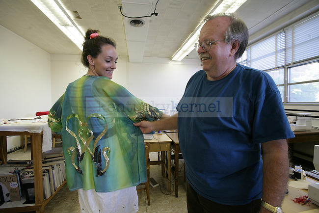 Robert Haven displays some of his embroidering work with grad student Chelsea McCown. Photo by Scott Hannigan | Staff