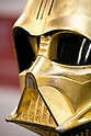 A gold plated Darth Vader mask on display at the Ginza Tanaka jewelry store on April 22, 2015, Tokyo, Japan. The jewelry store will sell a series of Star Wars themed golden coins from May 4th 2015 through to April 30, 2016, to commemorate the new Star Wars movie Episode VII The Force Awakens which is scheduled for release on December 18, 2015. Four kinds of 24k gold coins each with an individual with serial number will be sold with prices ranging from 500 USD to 8,000 USD. (Photo by Rodrigo Reyes Marin/AFLO)