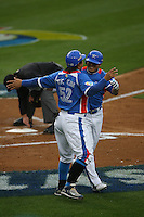Tae Kyun Kim and Shin Soo Choo of Korea during a game against Venezuela at the World Baseball Classic at Dodger Stadium on March 21, 2009 in Los Angeles, California. (Larry Goren/Four Seam Images)