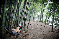 "A Chinese seller takes a rest in the Bamboo Sea National Park in Yibin, Sichuan, China, August 07, 2014. <br /> <br /> This image is part of the series ""24/7"", an ironic view on restless and fast-growing Chinese economy described through street vendors and workers sleeping during their commercial daily activity. <br /> <br /> © Giorgio Perottino"