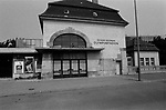The suburban S-Bahn station of the Olympic Stadium in West Berlin, during the period the city was divided and the railway run by the East German authorities. The Berlin Wall was a barrier constructed by the German Democratic Republic (GDR, East Germany) starting on 13 August 1961, that completely cut off West Berlin from surrounding East Germany and from East Berlin. The Wall was opened on 9. November 1989 allowing free movement of people from east to west.