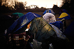 Melvin Sargent pokes his head out of his tent at the SafeGround camp in Sacramento, Calif., January 15, 2011.