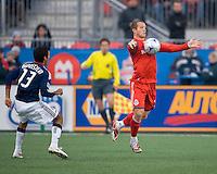 22 April 2009: Chivas USA defender Jonathan Bornstein #13 looks on as Toronto FC forward Chad Barrett #19 controls the ball at BMO Field in a MLS game between Chivas USA and Toronto FC.Toronto FC won 1-0. .