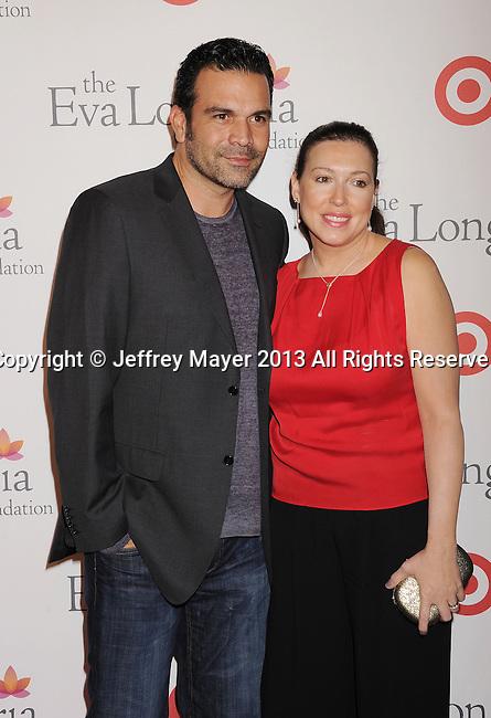 HOLLYWOOD, CA- SEPTEMBER 28: Actor Ricardo Antonio Chavira (L) and Marcea Dietzel arrive at the Eva Longoria Foundation Dinner at Beso restaurant on September 28, 2013 in Hollywood, California.
