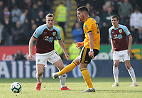 Wolverhampton Wanderers' Ruben Neves passes under pressure from Burnley's Chris Wood<br /> <br /> Photographer Rich Linley/CameraSport<br /> <br /> The Premier League - Burnley v Wolverhampton Wanderers - Saturday 30th March 2019 - Turf Moor - Burnley<br /> <br /> World Copyright © 2019 CameraSport. All rights reserved. 43 Linden Ave. Countesthorpe. Leicester. England. LE8 5PG - Tel: +44 (0) 116 277 4147 - admin@camerasport.com - www.camerasport.com