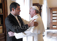 Pope Francis receives Ecuador's President Rafael Correa at the end of a private audience in his private library at the Vatican on  April 19, 2013
