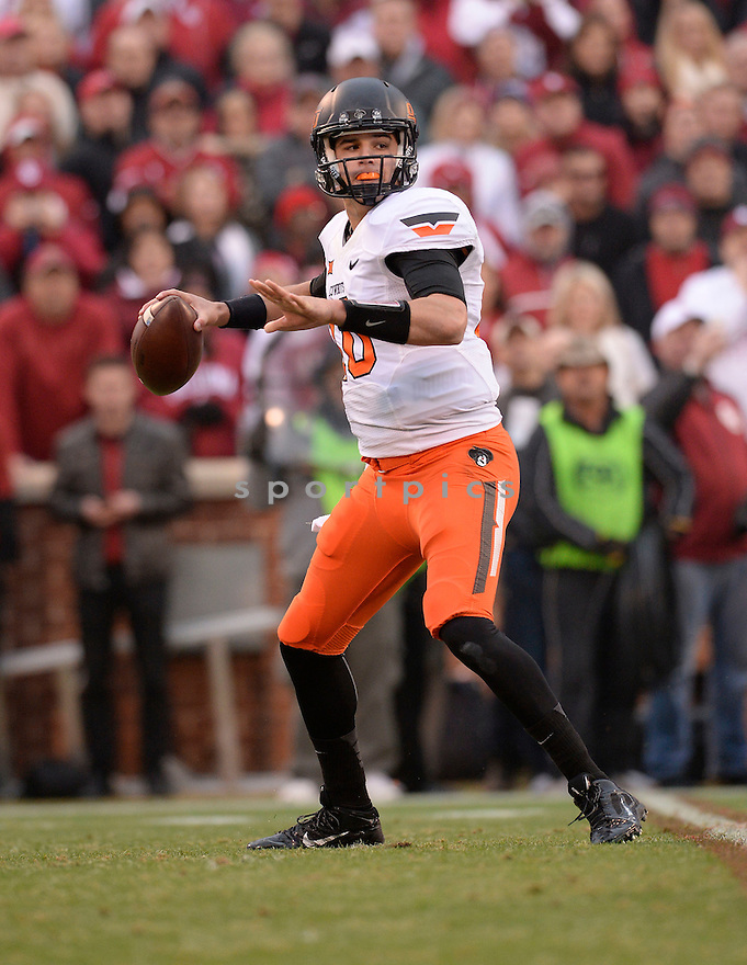 Oklahoma State Cowboys Mason Rudolph (10) during a game against the Oklahoma Sooners on December 6, 2014 at Oklahoma Memorial Stadium in Norman, OK. Oklahoma State beat Oklahoma 38-35