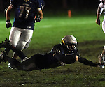 (Lexington MA 10/28/16) Lexington 28, Ben Quint, with a fumble recovery, during the first half, Friday, Oct 28, 2016, at Lexington High School. (Jim Michaud / Journal Inquirer)