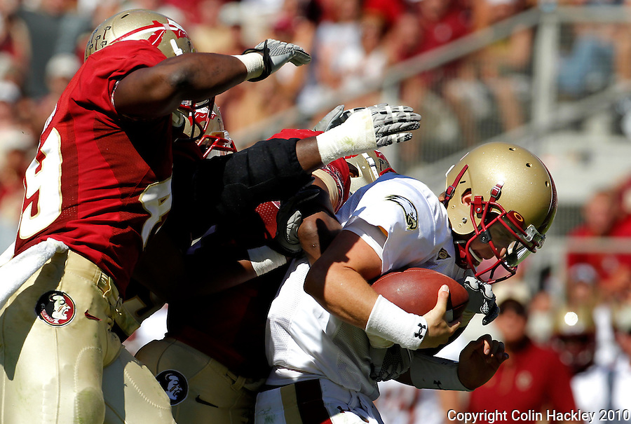 TALLAHASSEE, FL 10-FSU-BC 101610 FB10 CH-A trio of Florida State defenders sack Boston College Chase Rettig during second half action Saturday at Doak Campbell Stadium in Tallahassee. The Seminoles beat the Eagles 24-19. .COLIN HACKLEY PHOTO