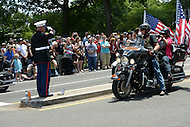 Washington, DC - May 25, 2014: Former Marine SSgt. Tim Chambers gets a return salute from a veteran as thousands of motorcycles participate in Rolling Thunder May 25, 2014. Each year, Rolling Thunder remembers and honors military veterans and fallen soldiers.  (Photo by Don Baxter/Media Images International)