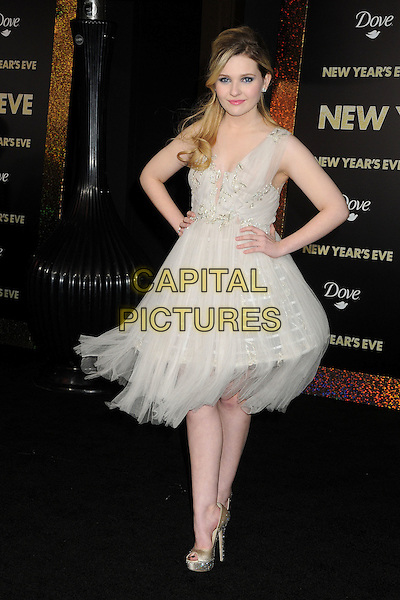 "Abigail Breslin.The World Premiere of ""New Year's Eve' held at The Grauman's Chinese Theatre in Hollywood, California, USA..December 5th, 2011.full length dress sleeveless wire structured hands on hips white beige sheer  .CAP/ADM/BP.©Byron Purvis/AdMedia/Capital Pictures."