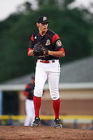 Batavia Muckdogs relief pitcher Parker Bugg (40) gets ready to deliver a pitch during a game against the State College Spikes on June 24, 2016 at Dwyer Stadium in Batavia, New York.  State College defeated Batavia 10-3.  (Mike Janes/Four Seam Images)