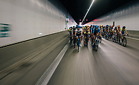 "peloton in the Tijsmans tunnel under the Antwerp harbour<br /> <br /> Antwerp Port Epic 2018 (formerly ""Schaal Sels"")<br /> One Day Race:  Antwerp > Antwerp (207 km; of which 32km are cobbles & 30km is gravel/off-road!)"
