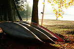 Canoes glow in the moring sun on the shore of lake Coeur D Alene