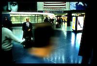 Penn Station.  Commuter waiting...New York City.  Street PhotographyNew York City, New York.  Street Photography from Manhattan and Brooklyn.  Subway, Union Square, Metro Stations, New York City Skyline, Michael Rubenstein, Matt Nager, Jacob Pritchard.