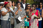 People become emotional during a remembrance ceremony for the 12th anniversary of the 9/11 terrorist attacks, at the Pentagon on September 11, 2013 in Arlington, Virginia. <br /> Credit: Kevin Dietsch / Pool via CNP