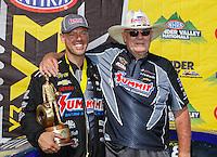 Jun 19, 2016; Bristol, TN, USA; NHRA pro stock driver Jason Line (left) celebrates with team owner Ken Black after winning the Thunder Valley Nationals at Bristol Dragway. Mandatory Credit: Mark J. Rebilas-USA TODAY Sports