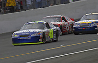 Jimmie Johnson (#48) leads Michael Waltrip (#15) and Dale Earnhardt, Jr.in the closing laps.