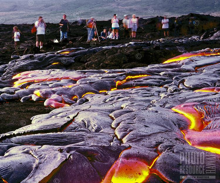 People watching lava flow from Kilauea crater, Hawaii Volcanoes National Park, Big Island of Hawaii