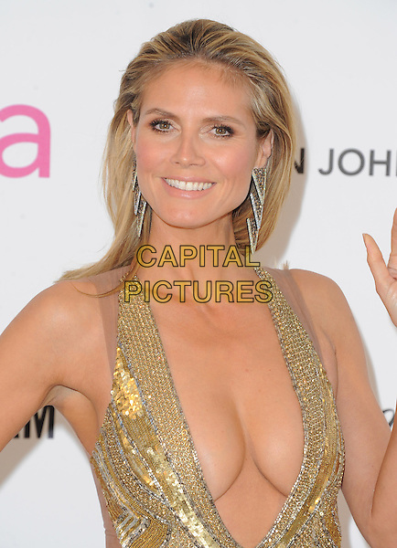 Heidi Klum.The 21st Annual Elton John AIDS Foundation Academy Awards Viewing Party held at The City of West Hollywood Park in West Hollywood, California, USA..February 24th, 2013.oscars headshot portrait gold diamante sequins sequined silver earrings plunging neckline cleavage .CAP/DVS.©DVS/Capital Pictures.