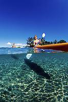 Kayaking couple (MR) , Kihei, Maui. Hawaii.