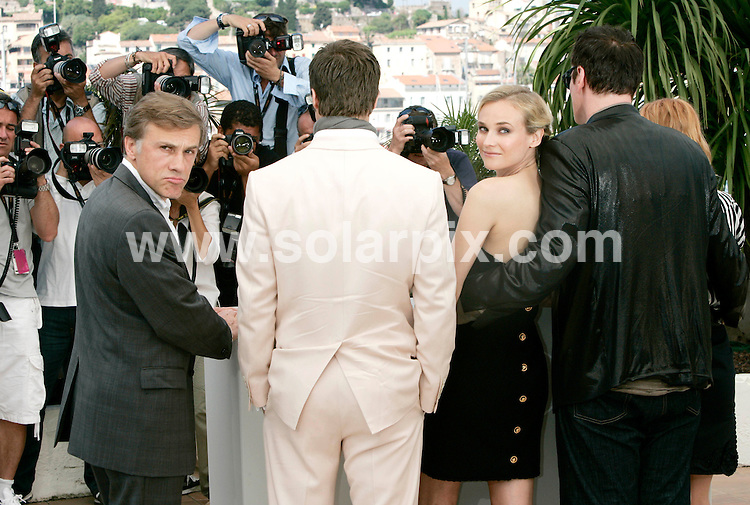 **ALL ROUND PICTURES FROM SOLARPIX.COM**.**SYNDICATION RIGHTS FOR UK AND SPAIN ONLY**.Quentin Tarantino, Melanie Laurent, Brad Pitt and Diane Kruger at a photocall for the film Inglorious Bastards, during the 62nd Cannes International Film Festival 2009, Cannes, France. 20 May 2009..This pic: Christophe Waltz, Brad Pitt, Diane Kruger and Quentin Tarantino..JOB REF: 9065 CPR (Heinz)  DATE: 20_05_2009.**MUST CREDIT SOLARPIX.COM OR DOUBLE FEE WILL BE CHARGED**.**ONLINE USAGE FEE GBP 50.00 PER PICTURE - NOTIFICATION OF USAGE TO PHOTO @ SOLARPIX.COM**.**CALL SOLARPIX : +34 952 811 768 or LOW RATE FROM UK 0844 617 7637**