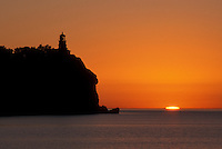 sunrise, Two Harbors, Lake Superior, MN, North Shore Drive, Minnesota, A sun rises behind Split Rock Lighthouse which is situated on a high cliff on the north shore of Lake Superior at Split Rock Lighthouse State Park in Two Harbors.
