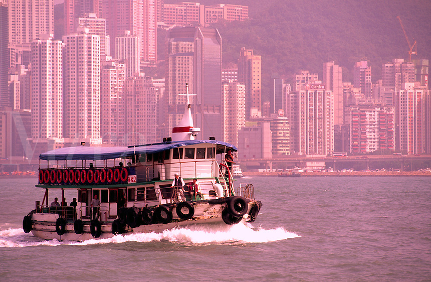 Ferry boat close up of harbour and beautiful Hong Kong Central District in background in todays busy business lif