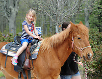 Kendra Leidtke, 5 of Kintnersville, Pennsylvania rides a pony during A Day at Del Val University Saturday April 23, 2016 in Doylestown, Pennsylvania. (Photo by William Thomas Cain)