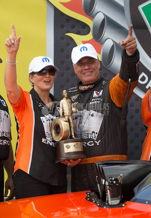 May 11, 2013; Commerce, GA, USA: NHRA funny car driver Johnny Gray celebrates with his wife after winning the Southern Nationals at Atlanta Dragway. Mandatory Credit: Mark J. Rebilas-
