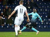 Modou Barrow of Swansea City FC looks to cross the ball into the box during the Premier League match between West Bromwich Albion and Swansea City at The Hawthorns, England, UK. Wednesday 14 December 2016
