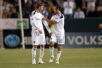 Head coach Bruce Arena asks Donovan (10) to give the Captains armband to David Beckham (23) as Donovan exits the pitch late in the match. The LA Galaxy defeated the Portland Timbers 3-0 at Home Depot Center stadium in Carson, California on  April  23, 2011....