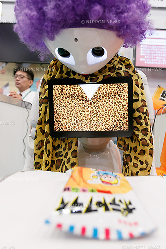SoftBank's humanoid robot Pepper scans a candy during SoftBank Robot World 2017 on November 21, 2017, Tokyo, Japan. SoftBank Robotics organized SoftBank Robot World 2017 to introduce AI (Artificial Intelligence) and IoT (the Internet of Things) companies developing the latest technology for robots, including applications its humanoid robot Pepper in various business fields. The robot expo runs until November 22. (Photo by Rodrigo Reyes Marin/AFLO)