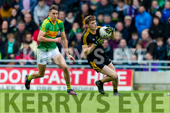 Gavin White Dr Crokes in action against John Curran South Kerry in the Senior County Football Final in Austin Stack Park on Sunday