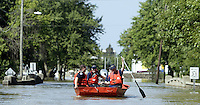 Members of the United States Coast Guard patrol the flooded waters of the Blanchard River after heavy rains caused flooding Thursday, August 23, 2007, in Findlay, Ohio. The Blanchard River was close to 7 feet above flood stage at Findlay yesterday morning, the highest since a 1913 flood.