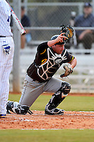 St. Bonaventure Bonnies catcher Nick Lohrer #11 looks for a passed ball during a game against the South Dakota State Jackrabbits at North Charlotte Regional Park on February 23, 2013 in Port Charlotte, Florida.  South Dakota State defeated St. Bonaventure 10-5.  (Mike Janes/Four Seam Images)