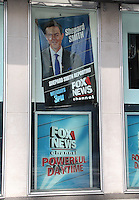 NEW YORK, NY - JULY 6:  FOX News personnel removing the poster of Gretchen Carlson at FOX News headquarters and replacing it with the poster of Shepard Smith following the announcement of Carlson's lawsuit against FOX News CEO Roger Ailes for sexual harassment  in New York, New York on July 6, 2016.  Photo Credit: Rainmaker Photo/MediaPunch