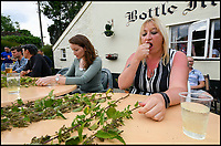 BNPS.co.uk (01202 558833)<br /> Pic: Graham Hunt/BNPS<br /> <br /> Sam George competing in the World Nettle Eating Championships at the Bottle Inn, Marshwood, Dorset, UK.