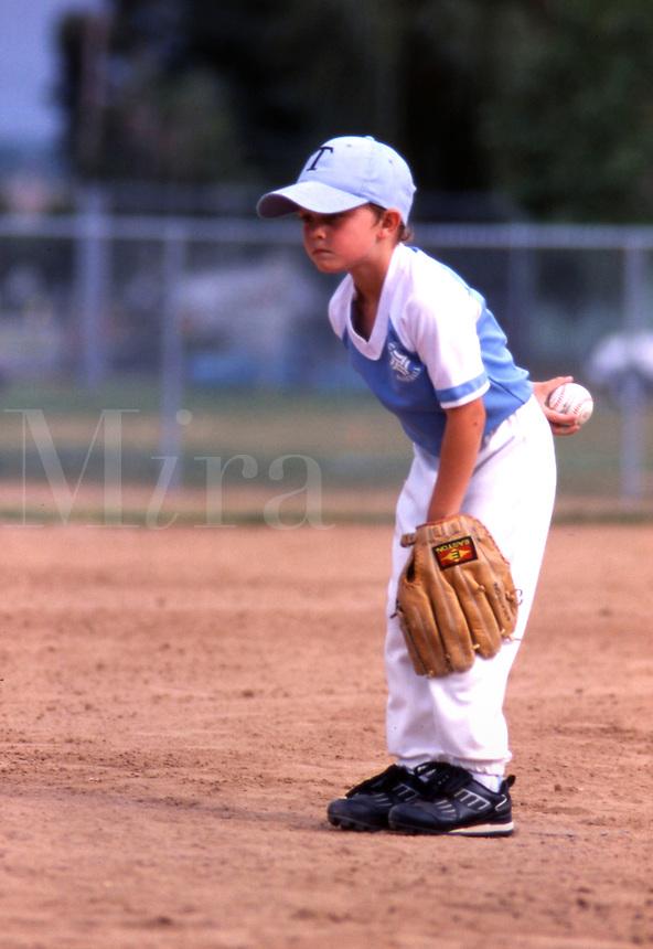Girl playing little league baseball.