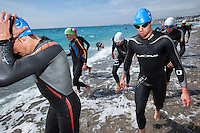 24 APR 2011 - NICE, FRA - Competitors walk from the water after warming up ahead of the first round of the 2011 French Grand Prix triathlon series (PHOTO (C) NIGEL FARROW)