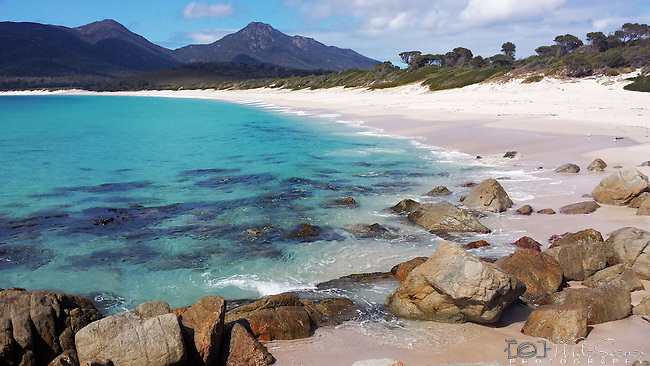 Wineglass Bay in Freycinet National Park, Coles Bay, Tasmania, Australia. This is Tasmania's most famous beach and images from the lookout feature in practically every brochure for the state. It can only be accessed by a steep walking track.