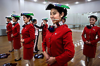 Olympic student volunteers learn to smile and stand straight at a vocational school in Beijing, which is getting ready to host the 2008 Olympic Games..