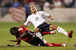 10 September 2008: Landon Donovan (USA) (10) reacts to a challenge from a Trinidad and Tobago player. The United States Men's National Team defeated the Trinidad and Tobago Men's National Team 3-0 at Toyota Park in Bridgeview, Illinois in a CONCACAF semifinal round FIFA 2010 South Africa World Cup Qualifier.