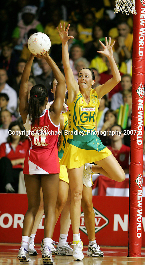 16.11.2007 Australian Liz Ellis and England's Pamela Cookey in action during the Australia v England match at the New World Netball World Champs held at Trusts Stadium Auckland New Zealand. Mandatory Photo Credit ©Michael Bradley.