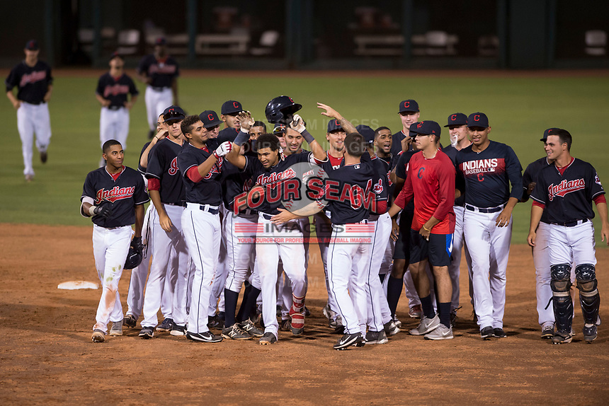 AZL Indians 1 shortstop Marcos Gonzalez (1) is congratulated by teammates after hitting a walk-off single during an Arizona League game against the AZL White Sox at Goodyear Ballpark on June 20, 2018 in Goodyear, Arizona. AZL Indians 1 defeated AZL White Sox 8-7. (Zachary Lucy/Four Seam Images)