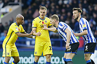 (L-R) Andre Ayew and Ben Wilmot of Swansea City are challenged by Sheffield United players during the Sky Bet Championship match between Sheffield Wednesday and Swansea City at Hillsborough Stadium, Sheffield, England, UK. Saturday 09 November 2019