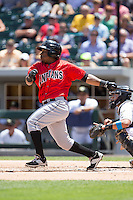 Gift Ngoepe (5) of the Indianapolis Indians follows through on his swing against the Charlotte Knights at BB&T BallPark on June 19, 2016 in Charlotte, North Carolina.  The Indians defeated the Knights 6-3.  (Brian Westerholt/Four Seam Images)