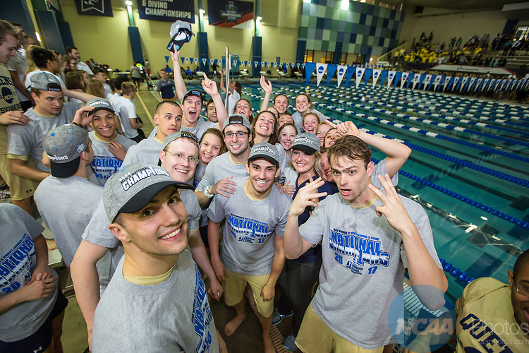 BIRMINGHAM, AL - MARCH 11: Queens University swimmers and divers celebrate after their Men's and Women's first place team victories during the Division II Men's and Women's Swimming & Diving Championship held at the Birmingham CrossPlex on March 11, 2017 in Birmingham, Alabama. The Men's team scored a combined total of 563.5 points and the Women compiled 467 points. (Photo by Matt Marriott/NCAA Photos via Getty Images)
